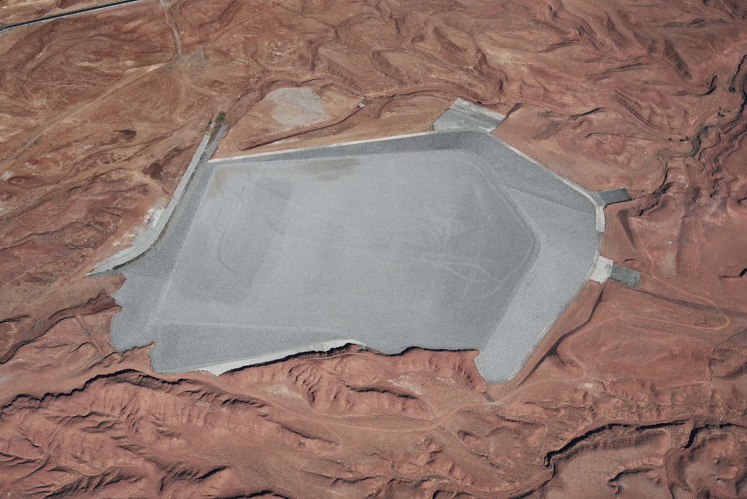 Color aerial photograph directed down at Mexican Hat Uranium Mill Tailings Repository