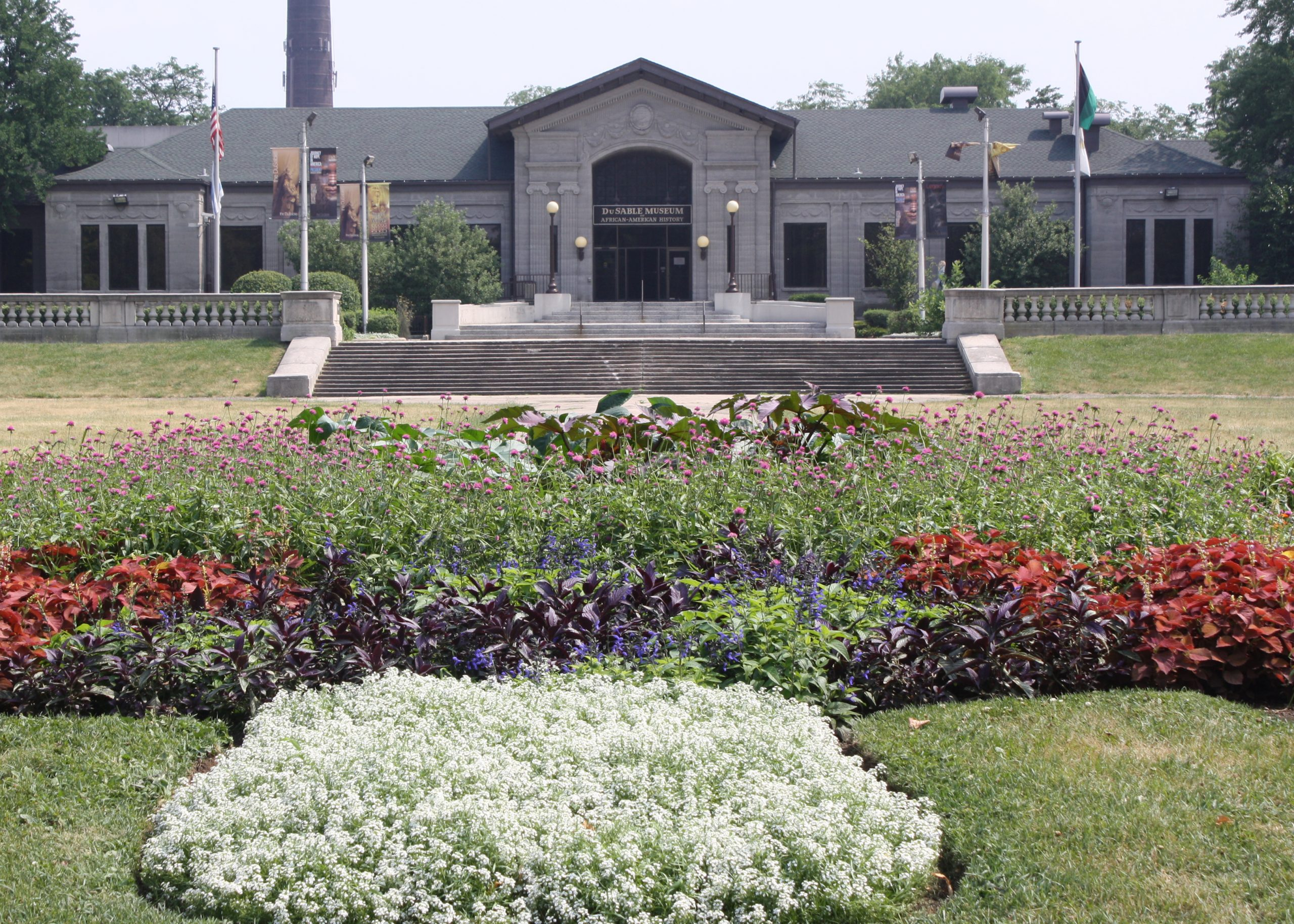 A flower garden blooms in front of the DuSable Museum building