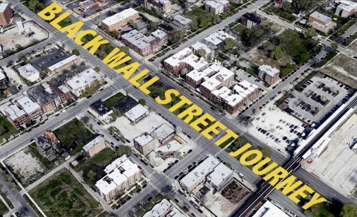 An aerial view of multiple city blocks with bold yellow text superimposed across a major street.