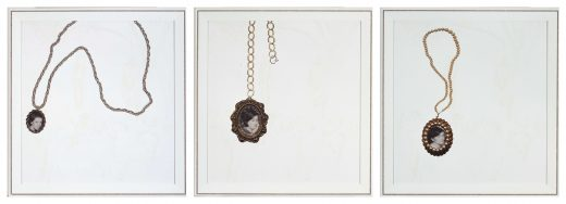 Three prints of locket style necklaces with black and white portraits inside.