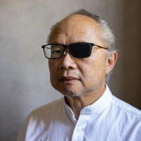 Headshot portrait of Mel Chin