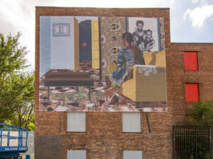 A large banner covers the side of a boarded up brick building