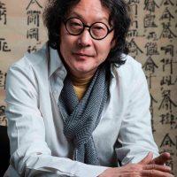 Headshot portrait of Xu Bing