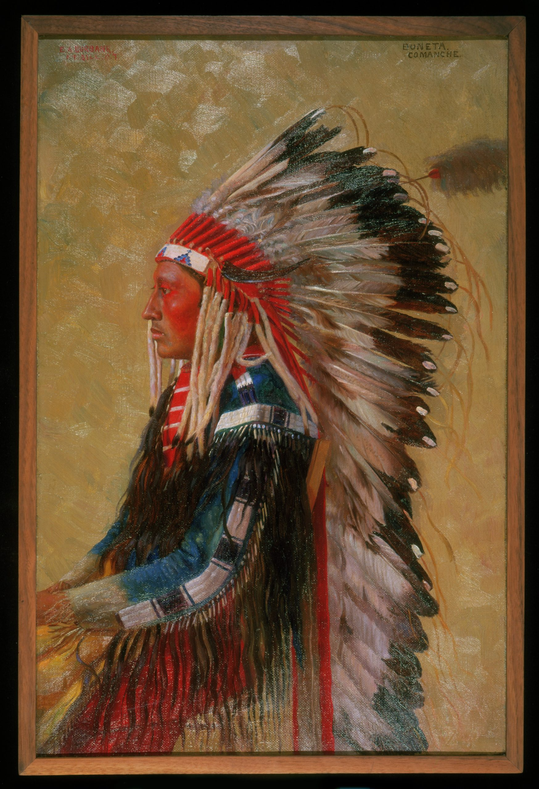 A portrait of a Native American man seated in profile.