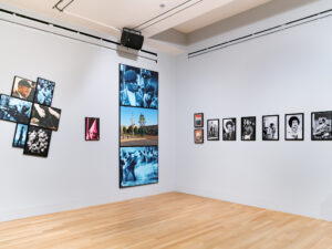 Gallery installation with multiple photographs depicting civil rights era scenes.