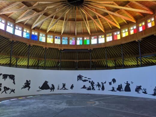 Large figurative black paper silhouettes adorn a round rotunda wall