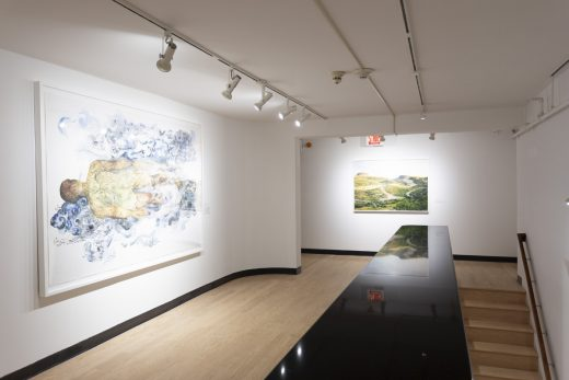 Gallery view with one large scale figure drawing and one landscape photograph