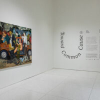 Gallery entry featuring a large comic painting and wall text.