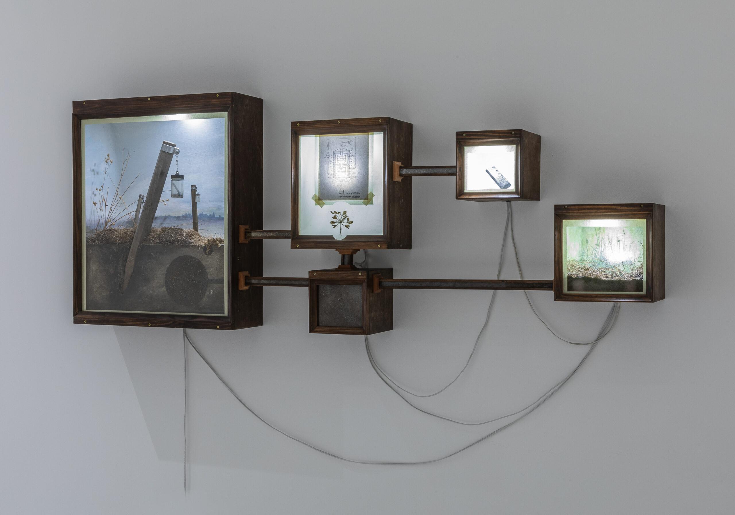 Gallery installation featuring an artwork diorama.