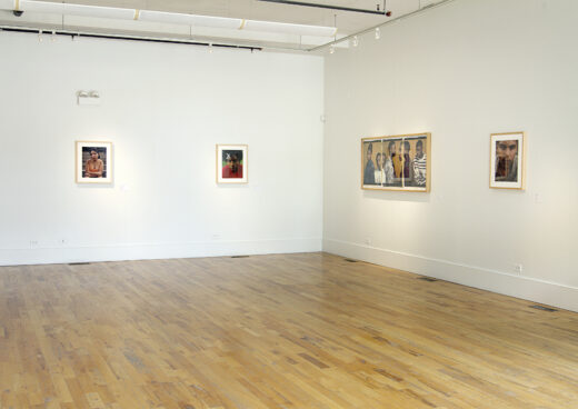 Gallery installation displaying four photographs, each a portrait of a student.