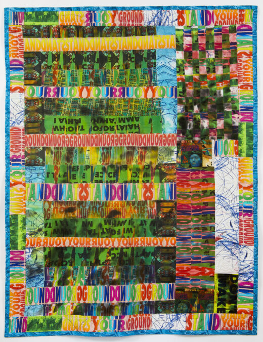 A brightly colored quilted collage repeats the words STAND YOUR GROUND