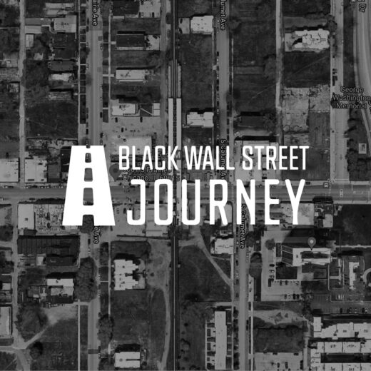 The words Black Wall Street Journey overlaid on a satellite map of a city block